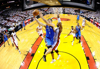 MIAMI, FL - JUNE 19:  Nick Collison #4 of the Oklahoma City Thunder drives for a shot attempt in the first half against Chris Bosh #1 of the Miami Heat in Game Four of the 2012 NBA Finals on June 19, 2012 at American Airlines Arena in Miami, Florida. NOTE