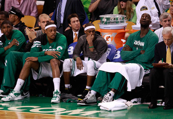 BOSTON, MA - JUNE 07:  Paul Pierce #34, Rajon Rondo #9 and Kevin Garnett #5 of the Boston Celtics look on from the bench late in the fourth quarter against the Miami Heat in Game Six of the Eastern Conference Finals in the 2012 NBA Playoffs on June 7, 201