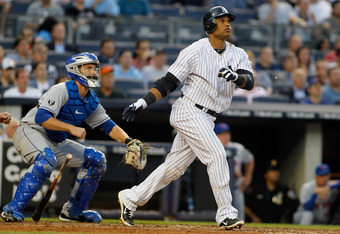 NEW YORK, NY - JUNE 08:  Robinson Cano #24 of the New York Yankees watches his second homerun of the game during the third-inning at Yankee Stadium on June 8, 2012 in the Bronx borough of New York City.Yankees defeated the Rays 7-0.  (Photo by Mike Stobe/