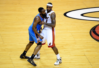 MIAMI, FL - JUNE 17:  James Harden #13 of the Oklahoma City Thunder fights for position against LeBron James #6 of the Miami Heat in Game Three of the 2012 NBA Finals on June 17, 2012 at American Airlines Arena in Miami, Florida.  NOTE TO USER: User expre