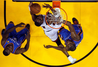 MIAMI, FL - JUNE 19:  Chris Bosh #1 of the Miami Heat attempts a shot against the Oklahoma City Thunder in Game Four of the 2012 NBA Finals on June 19, 2012 at American Airlines Arena in Miami, Florida. NOTE TO USER: User expressly acknowledges and agrees