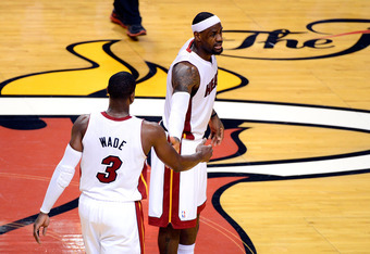 MIAMI, FL - JUNE 19:  (L-R) Dwyane Wade #3 and LeBron James #6 of the Miami Heat react against the Oklahoma City Thunder in Game Four of the 2012 NBA Finals on June 19, 2012 at American Airlines Arena in Miami, Florida. NOTE TO USER: User expressly acknow