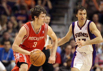 PHOENIX, AZ - FEBRUARY 09:  Goran Dragic #3 of the Houston Rockets drives the ball past Steve Nash #13 of the Phoenix Suns during the NBA game at US Airways Center on February 9, 2012 in Phoenix, Arizona. The Rockets defeated the Suns 96-89. NOTE TO USER: