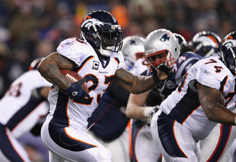 FOXBORO, MA - JANUARY 14:  Willis McGahee #23 of the Denver Broncos runs the ball against the New England Patriots during their AFC Divisional Playoff Game at Gillette Stadium on January 14, 2012 in Foxboro, Massachusetts.  (Photo by Elsa/Getty Images)