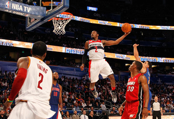 ORLANDO, FL - FEBRUARY 24:  John Wall #2 of the Washington Wizards and Team Chuck dunks during the BBVA Rising Stars Challenge part of the 2012 NBA All-Star Weekend at Amway Center on February 24, 2012 in Orlando, Florida.  NOTE TO USER: User expressly ac