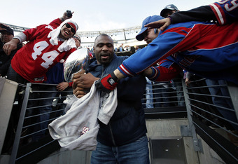 EAST RUTHERFORD, NJ - FEBRUARY 07:  Brandon Jacobs #27 of the New York Giants shares the Vince Lombardi Trophy with fans at a rally to celebrate the New York Giants' Super Bowl victory at MetLife Stadium on February 7, 2012 in East Rutherford, New Jersey.