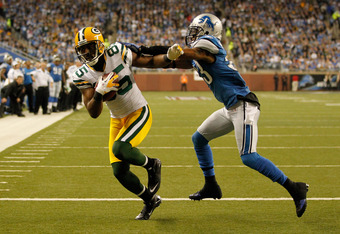 DETROIT, MI - NOVEMBER 24:  Wide receiver Greg Jennings #85 of the Green Bay Packers catches a three-yard touchdown pass against Brandon McDonald #33 of the Detroit Lions in the second quarter during the Thanksgiving Day game at Ford Field on November 24,
