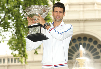 MELBOURNE, AUSTRALIA - JANUARY 30:  Novak Djokovic of Serbia poses with the Norman Brookes Challenge Cup after winning the 2012 men's Australian Open, at Carlton Gardens on January 30, 2012 in Melbourne, Australia.  (Photo by Lucas Dawson/Getty Images)
