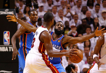 MIAMI, FL - JUNE 19:  James Harden #13 of the Oklahoma City Thunder defends against Dwyane Wade #3 of the Miami Heat in Game Four of the 2012 NBA Finals on June 19, 2012 at American Airlines Arena in Miami, Florida. NOTE TO USER: User expressly acknowledg