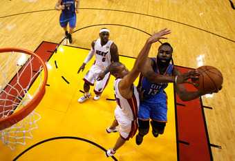 MIAMI, FL - JUNE 19:  James Harden #13 of the Oklahoma City Thunder drives for a shot attempt in the first half against Shane Battier #31 of the Miami Heat in Game Four of the 2012 NBA Finals on June 19, 2012 at American Airlines Arena in Miami, Florida.