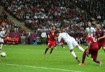 WARSAW, POLAND - JUNE 21:  Cristiano Ronaldo of Portugal scores the opening goal with a header during the UEFA EURO 2012 quarter final match between Czech Republic and Portugal at The National Stadium on June 21, 2012 in Warsaw, Poland.  (Photo by Alex Gr