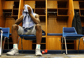 ST LOUIS, MO - MARCH 25:  Harrison Barnes #40 of the North Carolina Tar Heels sits dejected in the locker room after they lost 80-67 against the Kansas Jayhawks during the 2012 NCAA Men's Basketball Midwest Regional Final at Edward Jones Dome on March 25,