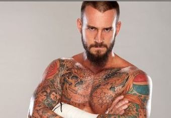 CM Punk, who looks less than thrilled to be photographed here (photo via fanpop.com)