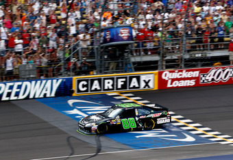 BROOKLYN, MI - JUNE 17:  Dale Earnhardt Jr., driver of the #88 Diet Mountain Dew/TheDarkKnightRises/National Guard/ Chevrolet, crosses the finishline to win the NASCAR Sprint Cup Series Quicken Loans 400 at Michigan International Speedway on June 17, 2012