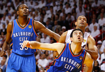 MIAMI, FL - JUNE 19:  Nick Collison #4 and Kevin Durant #35 of the Oklahoma City Thunder fight for rebound position in the first half against Shane Battier #31 of the Miami Heat in Game Four of the 2012 NBA Finals on June 19, 2012 at American Airlines Are