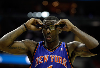 WASHINGTON, DC - JANUARY 06:  Amare Stoudemire #1 of the New York Knicks adjusts his goggles during the second half against the Washington Wizards at Verizon Center on January 6, 2012 in Washington, DC.  NOTE TO USER: User expressly acknowledges and agree