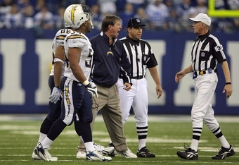 INDIANAPOLIS - JANUARY 13:  Head coach Norv Turner of the San Diego Chargers argues with replay official Gerald Austin #34 after the Charges had an inerception return for a touchdown by Antonio Cromartie #31 nullified by a holding call on the return in th