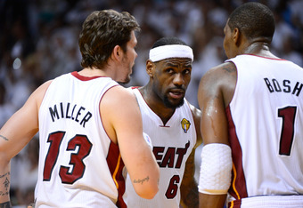 MIAMI, FL - JUNE 21:  (L-R) Mike Miller #13, LeBron James #6 and Chris Bosh #1 of the Miami Heat talk on court against the Oklahoma City Thunder in Game Five of the 2012 NBA Finals on June 21, 2012 at American Airlines Arena in Miami, Florida. NOTE TO USE