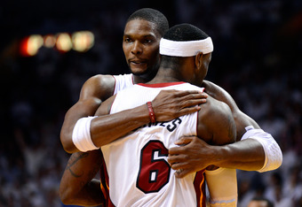 MIAMI, FL - JUNE 21:  Chris Bosh #1 and LeBron James #6 of the Miami Heat celebrate against the Oklahoma City Thunder in Game Five of the 2012 NBA Finals on June 21, 2012 at American Airlines Arena in Miami, Florida. NOTE TO USER: User expressly acknowled