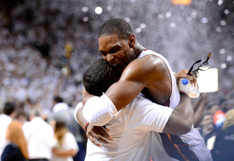 MIAMI, FL - JUNE 21:  Chris Bosh #1 of the Miami Heat celebrates after the Heat won  121-106 against the Oklahoma City Thunder in Game Five of the 2012 NBA Finals on June 21, 2012 at American Airlines Arena in Miami, Florida. NOTE TO USER: User expressly
