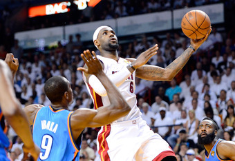 MIAMI, FL - JUNE 21:  LeBron James #6 of the Miami Heat drives for a shot attempt in the first half against Serge Ibaka #9 of the Oklahoma City Thunder in Game Five of the 2012 NBA Finals on June 21, 2012 at American Airlines Arena in Miami, Florida. NOTE