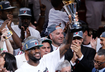 MIAMI, FL - JUNE 21:  LeBron James #6 of the Miami Heat celebrates with the Bill Russell Finals MVP trophy after they won 121-106 against the Oklahoma City Thunder in Game Five of the 2012 NBA Finals on June 21, 2012 at American Airlines Arena in Miami, F
