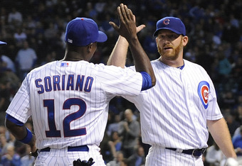 CHICAGO, IL - MAY 08: Alfonso Soriano #12 of the Chicago Cubs is congratulated by Ryan Dempster #46 after making a diving catch in the fourth inning against the Atlanta Braves on May 8, 2012 at Wrigley Field in Chicago, Illinois.  (Photo by David Banks/Ge