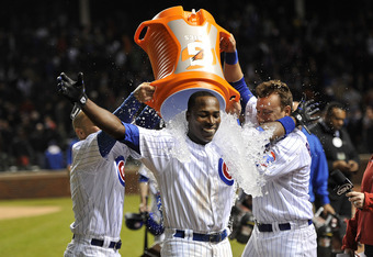 CHICAGO, IL - APRIL 24:   Alfonso Soriano #12 of the Chicago Cubs receives a Gatorade bath from teammates Reed Johnson #5 (L) and Jeff Baker #3 after hitting a game-winning RBI single scoring Tony Campana #1 during the 10th inning against the St. Louis Ca