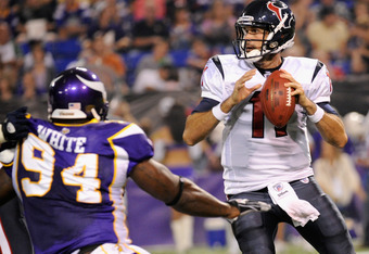 MINNEAPOLIS, MN - SEPTEMBER 1: Matt Leinart #11 of the Houston Texans looks to pass while under pressure from Stylez White #94 of the Minnesota Vikings in the first half on September 1, 2011 at Hubert H. Humphrey Metrodome in Minneapolis, Minnesota. (Phot
