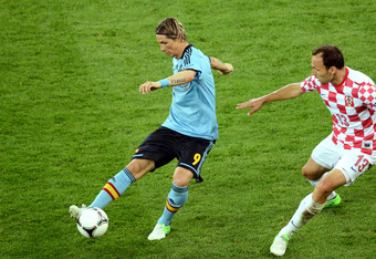 GDANSK, POLAND - JUNE 18:  Fernando Torres of Spain is shadowed by  Gordon Schildenfeld of Croatia during the UEFA EURO 2012 group C match between Croatia and Spain at The Municipal Stadium on June 18, 2012 in Gdansk, Poland.  (Photo by Jasper Juinen/Gett