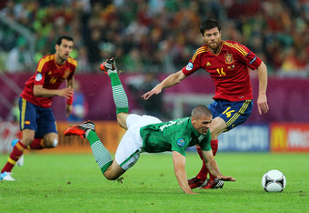 GDANSK, POLAND - JUNE 14:  Jonathan Walters of Republic of Ireland clashes with Xabi Alonso of Spain during the UEFA EURO 2012 group C match between Spain and Ireland at The Municipal Stadium on June 14, 2012 in Gdansk, Poland.  (Photo by Alex Grimm/Getty