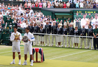 LONDON, ENGLAND - JULY 03:  Winner Novak Djokovic of Serbia (L) and runner-up Rafael Nadal of Spain hold their trophies after their final round Gentlemen's match on Day Thirteen of the Wimbledon Lawn Tennis Championships at the All England Lawn Tennis and