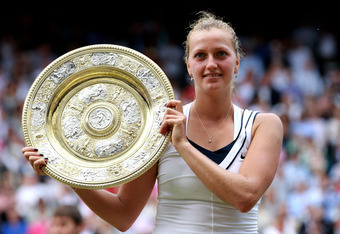 LONDON, ENGLAND - JULY 02:  Petra Kvitova of the Czech Republic holds up the Championship trophy after winning her Ladies' final round match against Maria Sharapova of Russia on Day Twelve of the Wimbledon Lawn Tennis Championships at the All England Lawn