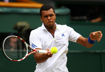 LONDON, ENGLAND - JULY 01:  Jo-Wilfried Tsonga of France returns a shot during his semifinal round match against Novak Djokovic of Serbia on Day Eleven of the Wimbledon Lawn Tennis Championships at the All England Lawn Tennis and Croquet Club on July 1, 2