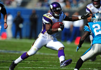 CHARLOTTE, NC - OCTOBER 30: Adrian Peterson #28 of the Minnesota Vikings carries the ball against the Carolina Panthers at Bank of America Stadium on October 30, 2011 in Charlotte, North Carolina. (Photo by Scott Cunningham/Getty Images)