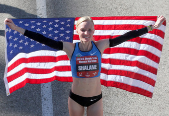 HOUSTON, TX - JANUARY 14:  Shalane Flanagan, who finished with a time of 2:25:38, holds an American flag after completing the U.S. Marathon Olympic Trials January 14, 2012 in Houston, Texas. (Photo by Thomas B. Shea/Getty Images)