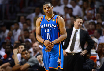 MIAMI, FL - JUNE 21:  Russell Westbrook #0 of the Oklahoma City Thunder grabs his wrist as head coach Scott Brooks looks on in the first half against the Miami Heat in Game Five of the 2012 NBA Finals on June 21, 2012 at American Airlines Arena in Miami,