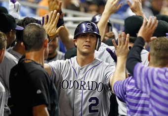 MIAMI, FL - MAY 21:  Troy Tulowitzki #2 of the Colorado Rockies is congratulated after hitting a three-run home run during a game against the Miami Marlins at Marlins Park on May 21, 2012 in Miami, Florida.  (Photo by Mike Ehrmann/Getty Images)