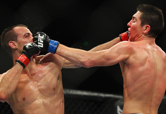 SYDNEY, AUSTRALIA - MARCH 03:  Cole Miller of the USA and Steven Siler of the USA exchange punches during the USC On FX featherweight bout between Cole Miller and Steven Siler at Allphones Arena on March 3, 2012 in Sydney, Australia.  (Photo by Mark Kolbe