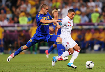 DONETSK, UKRAINE - JUNE 19:  Alex Oxlade-Chamberlain of England and Yaroslav Rakytskyy of Ukraine compete for the ball during the UEFA EURO 2012 group D match between England and Ukraine at Donbass Arena on June 19, 2012 in Donetsk, Ukraine.  (Photo by Al