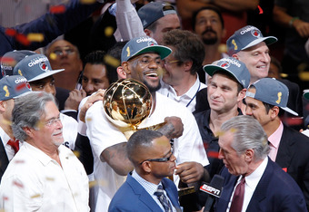MIAMI, FL - JUNE 21:  LeBron James #6 of the Miami Heat celebrates with the Larry O'Brien Finals Championship trophy after they won 121-106 against the Oklahoma City Thunder in Game Five of the 2012 NBA Finals on June 21, 2012 at American Airlines Arena i