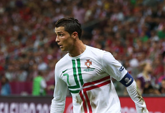 WARSAW, POLAND - JUNE 21: Cristiano Ronaldo of Portugal controls the ball during the UEFA EURO 2012 quarter final match between Czech Republic and Portugal at The National Stadium on June 21, 2012 in Warsaw, Poland.  (Photo by Alex Grimm/Getty Images)