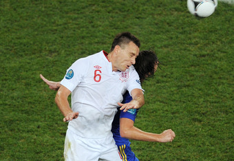 DONETSK, UKRAINE - JUNE 19: John Terry of England wins the header  during the UEFA EURO 2012 group D match between England and Ukraine at Donbass Arena on June 19, 2012 in Donetsk, Ukraine.  (Photo by Christopher Lee/Getty Images)