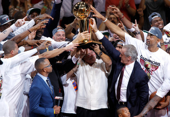 MIAMI, FL - JUNE 21:  Team owner Micky Arison of the Miami Heat holds up the Larry O'Brien Championship trophy as he celebrates with his players after they won 121-106 against the Oklahoma City Thunder in Game Five of the 2012 NBA Finals on June 21, 2012