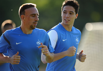 DONETSK, UKRAINE - JUNE 22: Samir Nasri of France talks with Franck Ribery as they train in the late evening sun at Kirsha Training Facility on June 22, 2012 in Donetsk, Ukraine.  (Photo by Laurence Griffiths/Getty Images)