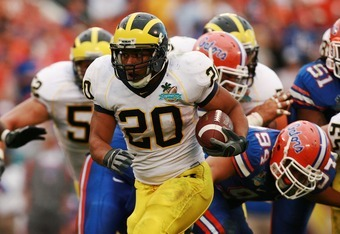 ORLANDO, FL - JANUARY 01:  Running back Mike Hart #20 of the Michigan Wolverines looks for room to run while taking on the Florida Gators in the Capital One Bowl at Florida Citrus Bowl on January 1, 2008 in Orlando, Florida. Michigan defeated Florida 41-3