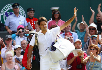 LONDON, ENGLAND - JUNE 30:  Roger Federer of Switzerland waves as he exits after losing his Quarter Final match against Tomas Berdych of Czech Republic on Day Nine of the Wimbledon Lawn Tennis Championships at the All England Lawn Tennis and Croquet Club