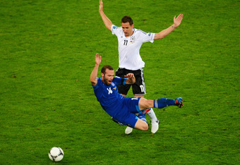 GDANSK, POLAND - JUNE 22:  Miroslav Klose of Germany clashes with Dimitris Salpigidis of Greece during the UEFA EURO 2012 quarter final match between Germany and Greece at The Municipal Stadium on June 22, 2012 in Gdansk, Poland.  (Photo by Shaun Botteril