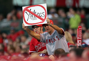 ANAHEIM, CA - OCTOBER 22:  An Angel fan hold up a sign in Game Five of the ALCS between the Los Angeles Angels of Anaheim and the New York Yankees during the 2009 MLB Playoffs at Angel Stadium on October 22, 2009 in Anaheim, California.  (Photo by Stephen