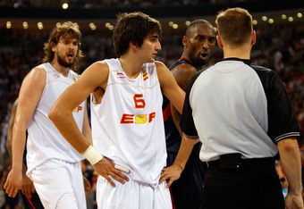 BEIJING - AUGUST 24:  Kobe Bryant #10 of the United States speaks to an official as Ricky Rubio #6 and Marc Gasol #13 of Spain look on in the gold medal game during Day 16 of the Beijing 2008 Olympic Games at the Beijing Olympic Basketball Gymnasium on Au